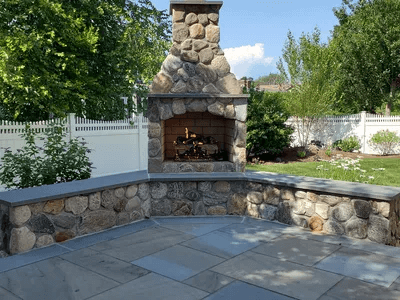 outdoor fireplace by Waterview landscaping